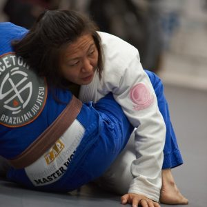 Emily Kwok rolling with a brown belt student
