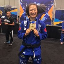Emily Kwok smiles with her gold medal after competition